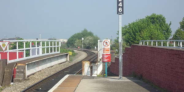 Trespass image of signs at the end of platform